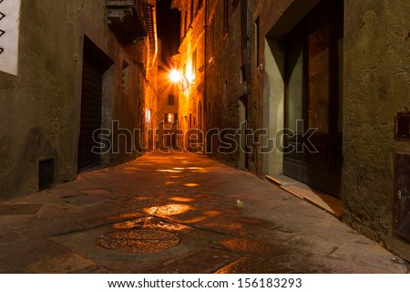 mysterious narrow alley with lanterns at night