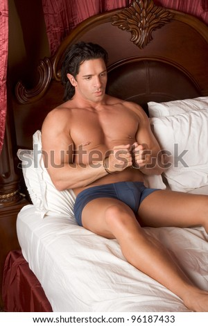 mystery handcuffed man in bed