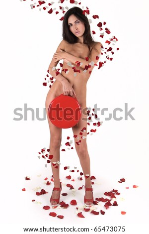 naked girl in rose petals on white background