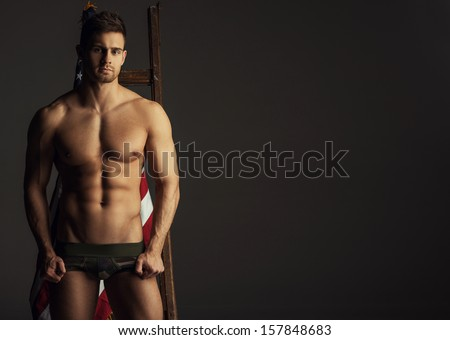 Naked man with ladder