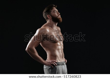 Naked muscular man in profile. isolated dark background