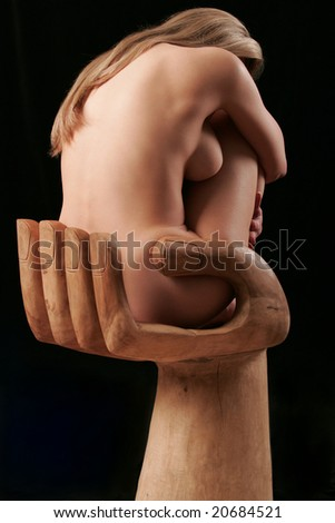 Naked young woman sit on wood hand
