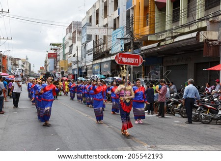 NAKHON RATCHASIMA, THAILAND - JULY 12 : Unidentified dancers perform traditional Thai-Esan dance on traditional candle procession festival of Buddha, on July 12, 2014 in Nakhon Ratchasima, Thailand.