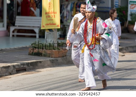 Nakhon Ratchasima, THAILAND - OCT 16 : An unidentified devotee of Vegetarian Festival, person who invites the spirits of gods to possess their bodies on October 16, 2015 in Nakhon Ratchasima, Thailand