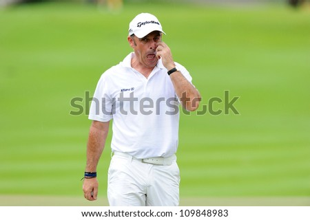 NAKHONPATHOM,THAILA ND-AUG 9:Paul Mcginley of IRL walks towards during hole12 day one of the Golf Thailand Open at Suwan Golf&Country Club on August 9, 2012 in Nakhonpathom Thailand