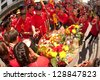 NAKHONSAWAN, THAILAND-FEB 13 : Oracle (a medium who communicate with spirits) of gods doing ritual at worship table of people in Chinese New Year Celebrations on February 13, 2013 in Thailand . - stock photo