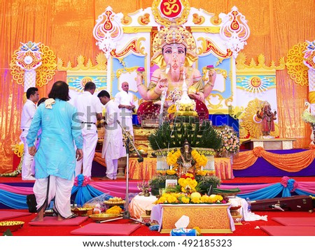 NAKHONSAWAN/ THAILAND-SEPTEMBER 11, 2016: Head of Brahmans and celebrity guests worship God with marigold flowers in Ganesh God Anniversary Birthday Festival.