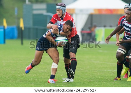 NANJING, CHINA-AUGUST 19: USA Rugby Team (white) plays against Japan Rugby Team (red) during Day 3 match of 2014 Youth Olympic Games on August 19, 2014 in Nanjing, China. USA wins 29-12.