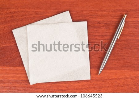 Napkin and pen on table