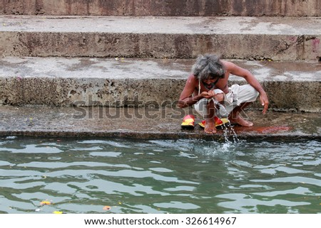 NASHIK - SEP 14:Unidentified Sadhu does rituals in the river Godavari during the event Kumbh Mela on September 14, 2015 in Nashik, India.Kumbhmela is a Hindu religious event gathered by millions.