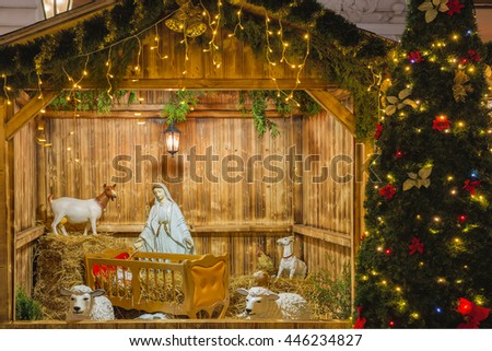 Gate decorated christmas light tree front stock photo for Baby jesus christmas decoration