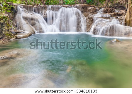 Natural background of waterfall cascade and clear water in National Park.