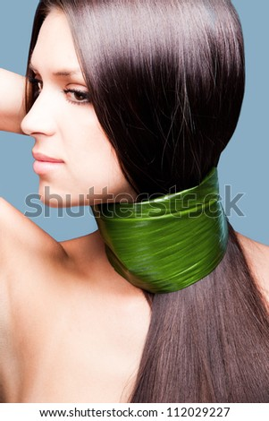 natural beauty woman portrait with leaf around hair and nack profile studio shot vertical