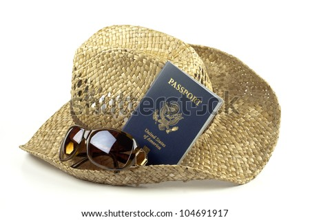 Natural brown straw sun hat with sunglasses and American passport isolated on white background with copy space.