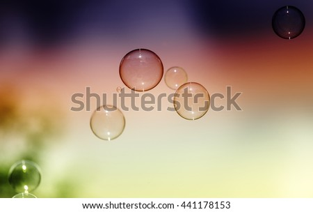 Natural heaven background, soap bubbles on background of sky, toned image, selective focus