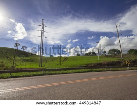 Natural landscape view of country road nearby paddy field in rural area of Thailand, Southeast Asia, Phetchabun