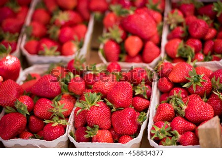 Natural organic strawberries in boxes at a farmers market