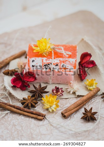 Natural soap with cinnamon and anise stars on a brown paper. Aromatherapy
