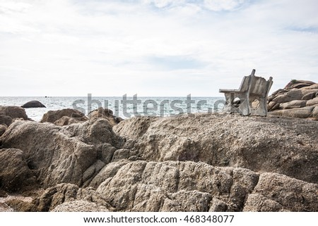 nature scene rock and chair for relax on  beach in rayong,banchang, Thailand