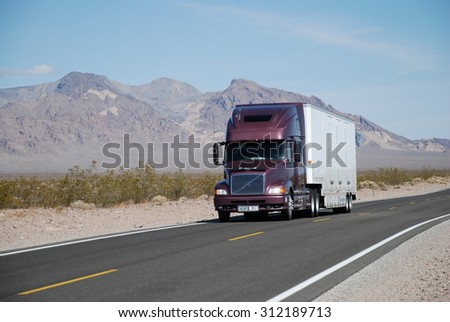 NEAR SHOSHONE, CA, USA - APRIL 21, 2007: a truck drives on Route 127. Trucks carry nearly 70 percent of all freight transported annually in the U.S.