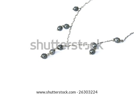 Necklace with gray beads on white background.