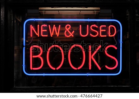 "Neon sign that says, ""NEW & USED BOOKS"""