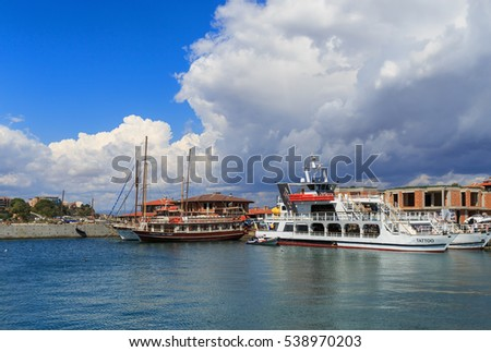 Nesebar, Bulgaria - September 06, 2013: Ships and boats in the port of the old town Nessebar on the bulgarian Black Sea coast. Sunny summer day. UNESCO world heritage site.