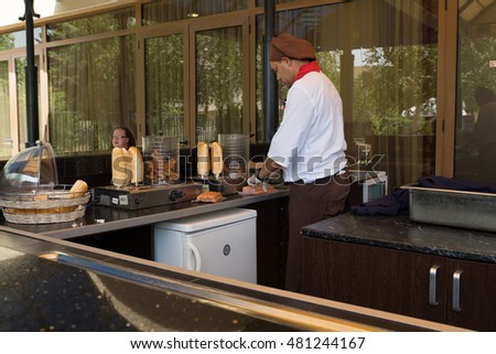 Nessebar, Bulgaria - JUNE 19, 2016: Hotel Sol Nessebar one of the best hotel chains in Bulgaria on the Black Sea coast. The cook prepares food for guests.