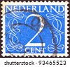 NETHERLANDS - CIRCA 1946: A stamp printed in the Netherlands shows it's value of 2 cent, circa 1946. - stock photo