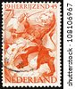 NETHERLANDS - CIRCA 1945: a stamp printed in the Netherlands shows Lion and Dragon, Liberation of Netherlands, Rising Again, circa 1945 - stock photo