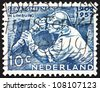 NETHERLANDS - CIRCA 1952: a stamp printed in the Netherlands shows Miner at Work, 50th Anniversary of the Founding of Netherlands Mining Industry, circa 1952 - stock photo