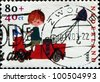 NETHERLANDS - CIRCA 1999: Stamp printed in Netherlands shows Characters created by Fiep Westendorp, Pluk van de Pettevlet on Fire Engine, circa 1999 - stock photo