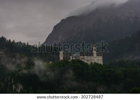 Neuschwanstein Castle being covered by fog