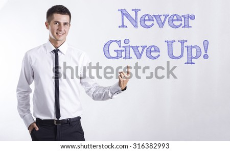 Never Give Up! - Young smiling businessman pointing on text