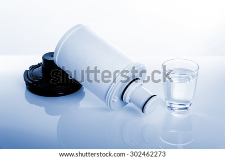 new cartridge for water purifier on white background
