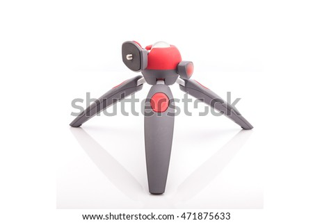 New mini tripod for camera isolated on white background