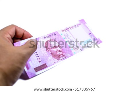New series of 2000 Indian rupee currency,money in a hand isolated on white background with copy space,Focus on eye of gandhi a man on banknote