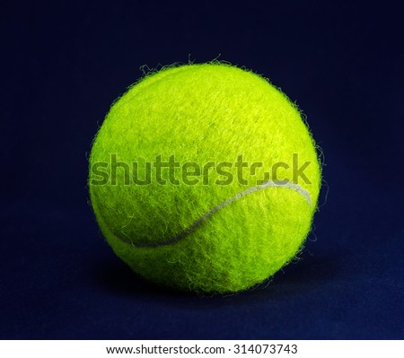 New tennis ball on blue background