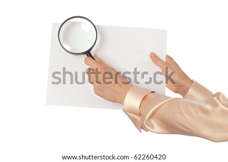 New worker looking at the white blank paperwith a magnifier