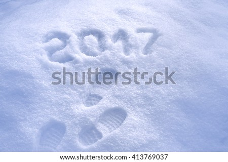 New Year 2017 greeting, footprints in snow, new year 2017, 2017 greeting card