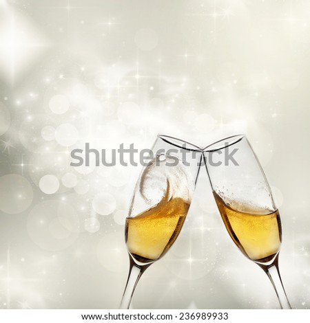 New Year's at midnight - champagne glasses and fireworks
