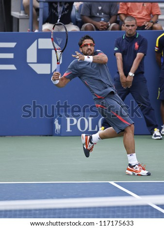 NEW YORK - AUGUST 31: Janko Tipsarevic of Serbia returns ball during 2nd round match against Brian Baker of USA at US Open tennis tournament on August 31, 2012 in Flushing Meadows New York