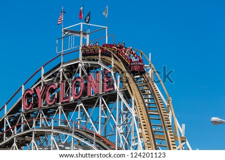NEW YORK - AUGUST 12: The Cyclone located at Luna Park in Coney Island NY on August 12, 2012. It was declared NYC landmark in 1988 and was placed on the National Register of Historic Places in 1991
