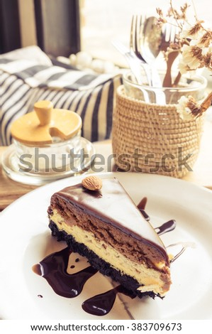 New York chocolate cheese cake slice in cozy restaurant
