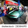 NEW YORK CITY - APRIL 10 : A luxury car model on display at NY International Auto Show 2009 April 10, 2009 in New York. More than 1 million visitors expected to visit the annual auto show. - stock photo