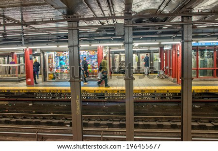 NEW YORK CITY - APRIL 22, 2013: Interior of subway station with people waiting for train. The NYC Subway is one of the most extensive public transportation systems in the world, with 468 stations.