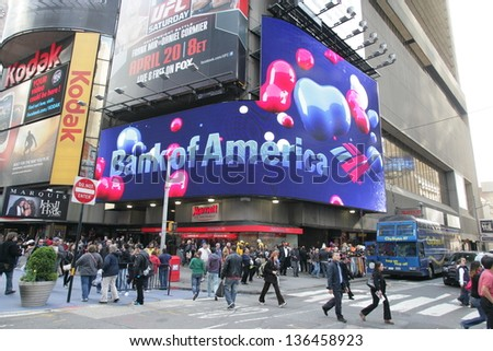 NEW YORK CITY - APRIL 19: Pedestrians walk past a giant sign advertising a Bank of America branch office  in New York City, on Friday, April 19, 2013.