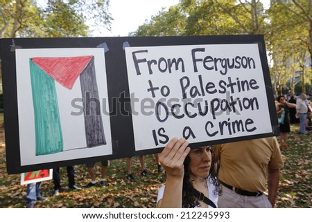 NEW YORK CITY - AUGUST 20 2014: Solidarity with Palestine hosted a rally at Cadman Plaza, Brooklyn followed by a march in sympathy with Gaza across the Brooklyn Bridge & assembly at One Police Plaza