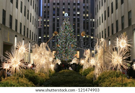 NEW YORK CITY - DEC. 8, 2012: New York City landmark, The famous Rockefeller Center Christmas tree viewed from the Channel Gardens, Dec. 8, 2012, celebrating the 80th anniversary of the tradition.