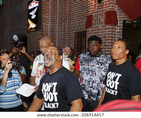 NEW YORK CITY - JULY 23 2014: Funeral services for Eric Garner, the Staten Island resident who died while being taken into custody by NYPD.  Activist displays passion during funeral